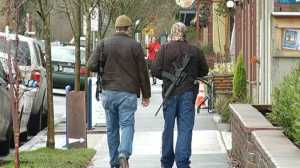 Men armed with rifles walk through Portland to 'educate'
