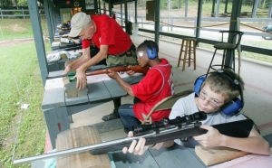 Just the kind of things we need to teach our kids, namely that guns and violence are the answer and that the tools of violence and murder are cool. The NRA and its foundation maintain ties with several youth groups, such 4-H and the Boy Scouts of America. Boy Scouts from Georgia and Miami gets some pointers at the range at the Boy Scouts' Camp Woodruff outside Blairsville, Ga., in 2005