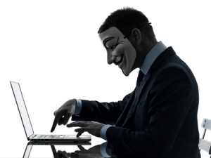 man masked anonymous group member computing computer silhouette
