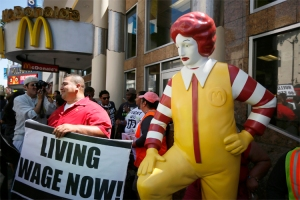 Striking McDonald's worker Bartolome Perez, 42, protests outside McDonald's on Hollywood Boulevard as part of a nationwide strike by fast-food workers to call for wages of $15 an hour, in Los Angeles
