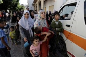 Displaced Palestinians leave the hospital to seek other shelter after an Israeli airstrike hit their pervious shelter in U.N school, at Beit Hanoun hospital, in the northern Gaza Strip, Thursday, July 24, 2014. Israeli tank shells hit a compound housing a U.N. school in the Gaza Strip on Thursday, killing more than a dozen of people and wounding dozens who were seeking shelter from fierce clashes on the streets outside, Palestinian officials said, as Israel pressed forward with its 17-day war against the territory's Hamas rulers.